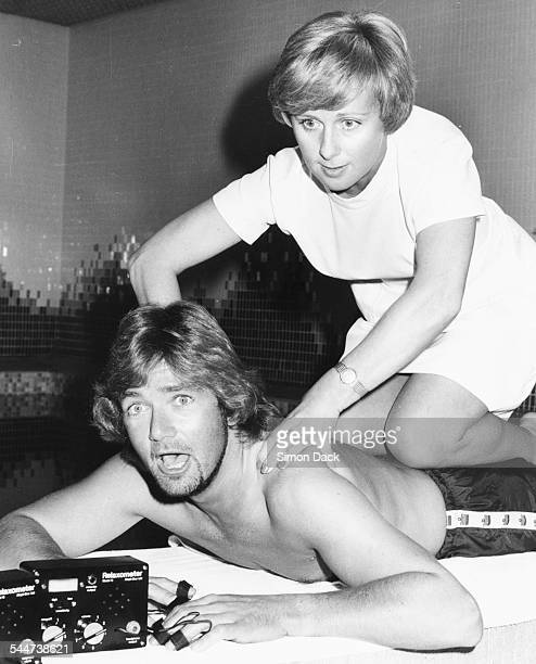 BBC presenter Noel Edmonds being given a massage by beauty therapist Barbara Waller at the Gym and Tonic Health Club London July 6th 1981