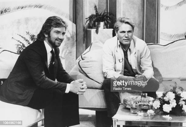 Presenter Noel Edmonds interviewing singer Adam Faith on the BBC series 'The Time of Your Life' May 13th 1985