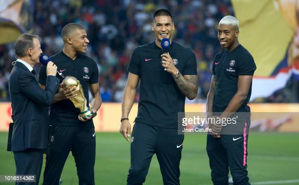 Presenter of PSG Michel Montana presents the three Parisians World Champions in Russia Kylian Mbappe holding the World Cup trophy goalkeeper Alphonse...