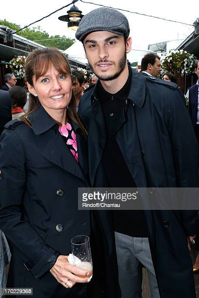 Presenter of the program Telematin on France 2 TV chanel Isabelle Chalencon and singer Baptiste Giabiconi sighting at the Roland Garros Tennis French...