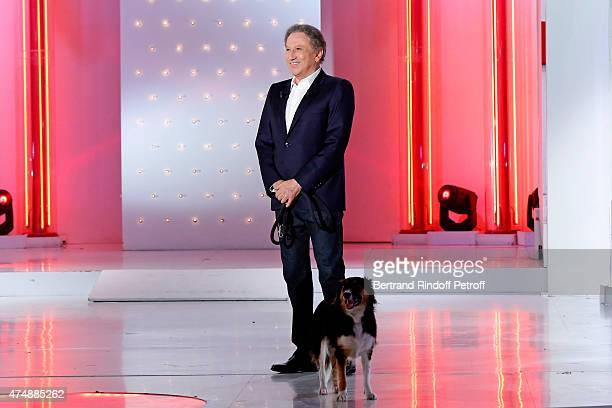 Presenter of the show Michel drucker and his dog Isia attend the 'Vivement Dimanche' French TV Show at Pavillon Gabriel on May 27 2015 in Paris France