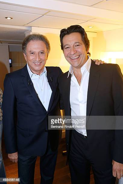 Presenter of the show Michel Drucker and Main Guest of the Show Impersonator Laurent Gerra attend the 'Vivement Dimanche' French TV Show at Pavillon...