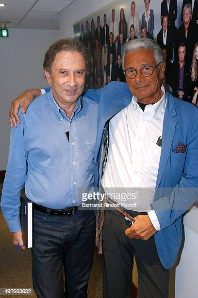 Presenter of the show Michel Drucker and Photographer JeanMarie Perier attend the 'Vivement Dimanche' French TV Show at Pavillon Gabriel on October...