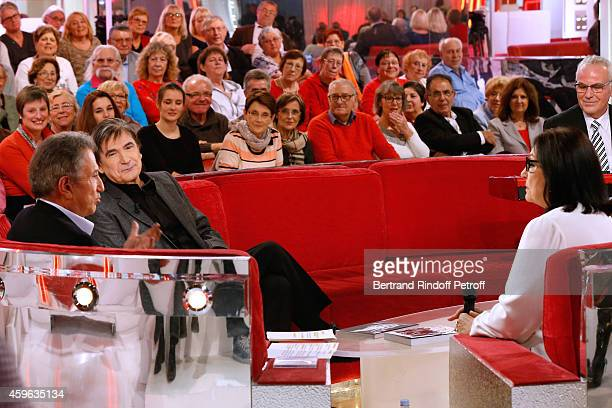 Presenter of the show Michel Drucker, Singer Serge Lama and Main Guest of the show, singer Nana Mouskouri attend the 'Vivement Dimanche' French TV...