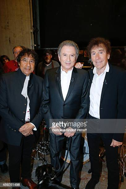 Presenter of the show Michel Drucker standing between Main Guests of the show singers Alain Souchon and Laurent Voulzy who present their new album...