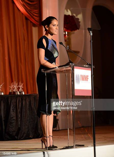 Presenter Olivia Munn speaks onstage at the 2012 Courage in Journalism Awards hosted by the International Women's Media Foundation held at the...