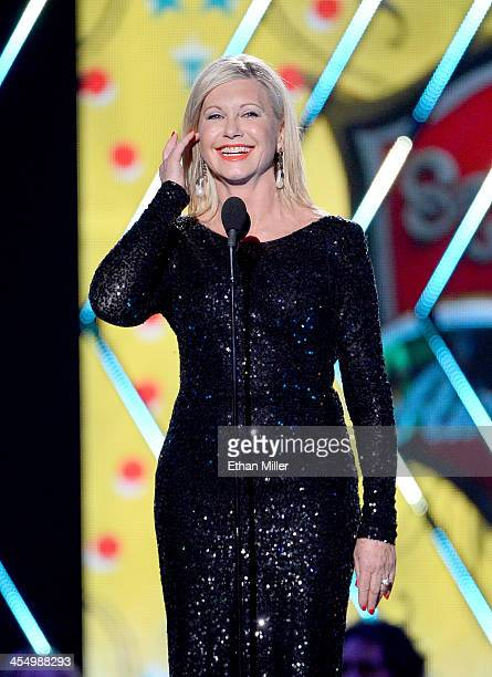 Presenter Olivia Newton-John speaks onstage during the American Country Awards 2013 at the Mandalay Bay Events Center on December 10, 2013 in Las...