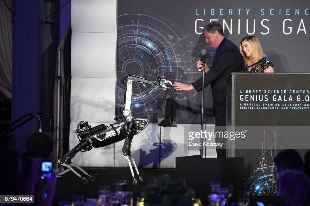 Presenter, Olympic Wrestling Gold Medalist Helen Maroulis and CEO and President of Liberty Science Center Paul Hoffman present and award to SpotMini...