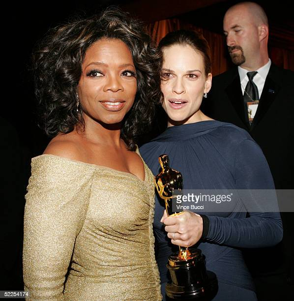 TV presenter Oprah Winfrey and actress Hilary Swank attend the Governors Ball after the 77th Annual Academy Awards at the Renaissance Hollywood Hotel...