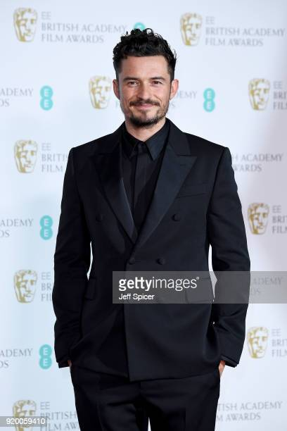 Presenter Orlando Bloom poses in the press room during the EE British Academy Film Awards held at Royal Albert Hall on February 18 2018 in London...