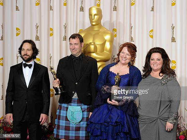 Presenter Paul Rudd, animators Mark Andrews, animator Brenda Chapman and presenter Melissa McCarthy pose in the press room during the Oscars at the...