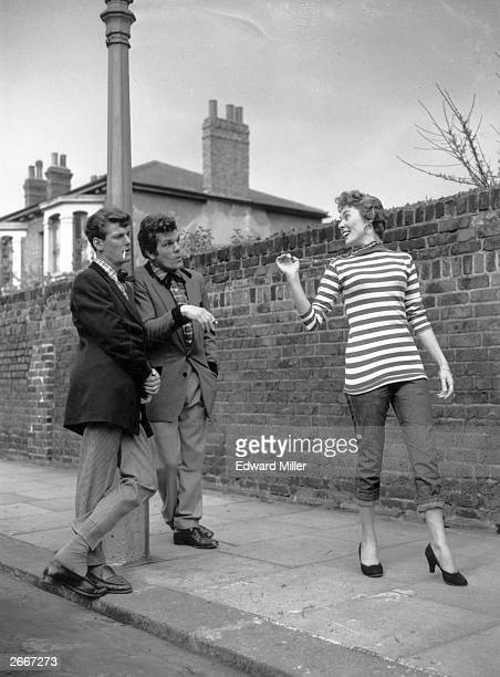 Presenter Peter Murray former boxer Freddie Mills and Josephine Douglas at Shepherd's Bush London rehearsing their roles as Teddy Boys for an edition...