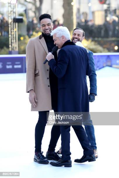Presenter Phillip Schofield interviews judges Jason Gardiner and Ashley Banjo during the Dancing On Ice 2018 photocall held at Natural History Museum...