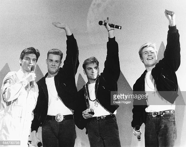 Presenter Phillip Schofield presenting an award to the band 'Big Fun' at the Smash Hits Awards London October 29th 1989