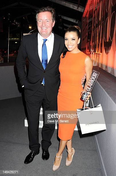 Presenter Piers Morgan and actress Eva Longoria pose at the Glamour Women of the Year Awards in association with Pandora at Berkeley Square Gardens...