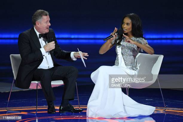 TV presenter Piers Morgan interviews Miss Jamaica ToniAnn Singh during the Miss World Final 2019 at the Excel arena in east London on December 14 2019