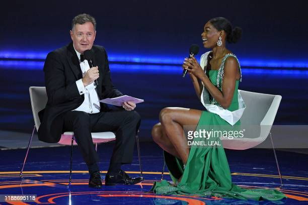 TV presenter Piers Morgan interviews Miss Nigeria Nyekachi Douglas during the the Miss World Final 2019 at the Excel arena in east London on December...