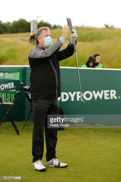 Presenter Piers Morgan takes a photo on his mobile phone as he takes part in the Paddypower Pro-Am Golf Shootout on June 5, 2020 in St Albans, United...