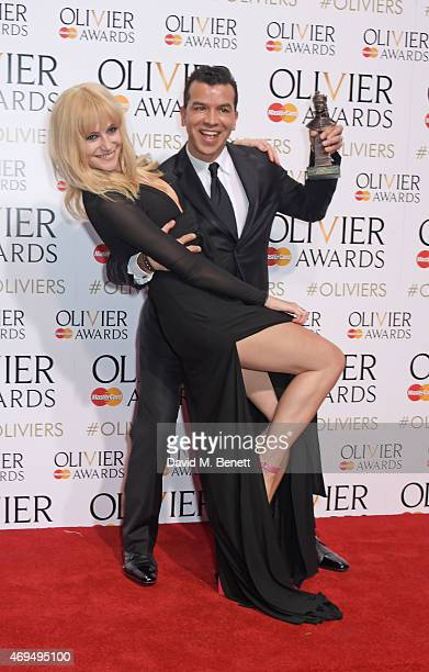 Presenter Pixie Lott and Sergio Trujillo winner of the Best Theatre Choreographer pose in the winners room at The Olivier Awards at The Royal Opera...
