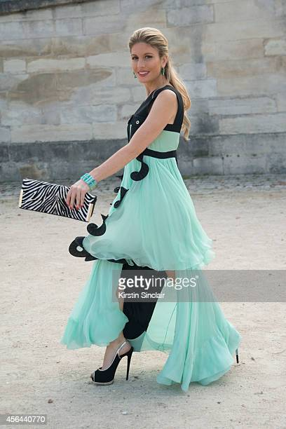 Presenter Producer Spokesmodel and Entrepreneur Hofit Golan is wearing an Emanuel Ungaro dress and bag and Giuseppe Zanotti shoes on day 7 of Paris...
