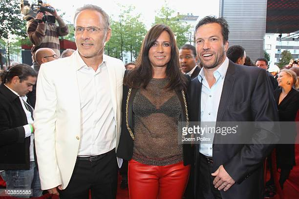 Presenter Reinhold Beckmann and his wife Kerstin and Lothar Matthaeus attend the Day of Legends gala Night of Legends at the Schmitz Tivoli theatre...