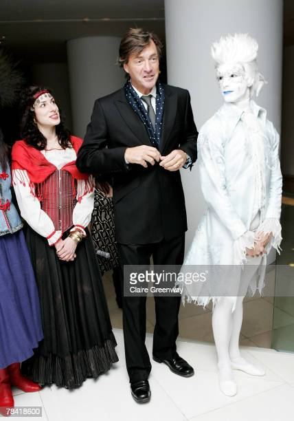 TV presenter Richard Madeley poses with dancers at the drinks reception prior to the VIP performance of 'Night of The Snow Queen' at St Martin's Lane...