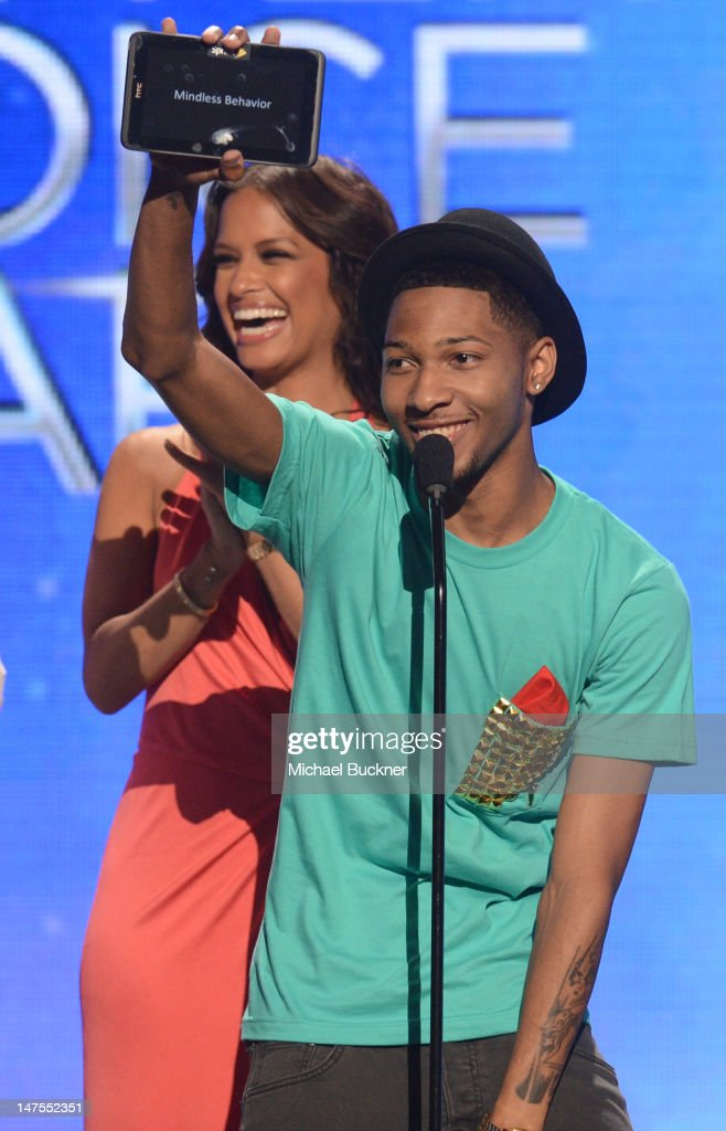 Presenter Rocsi Diaz and BET Ultimate Fan winner Blair Caldwell speak onstage during the 2012 BET Awards at The Shrine Auditorium on July 1, 2012 in Los Angeles, California.