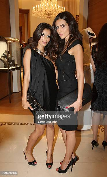 Presenter Rosamin Manji and a guest pose for a photograph during the inauguration of the new Cartier Boutique at Dubai Mall on March 26 2009 in Dubai...