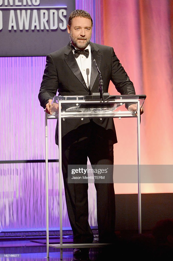 Presenter Russell Crowe onstage during the 15th Annual Costume Designers Guild Awards with presenting sponsor Lacoste at The Beverly Hilton Hotel on February 19, 2013 in Beverly Hills, California.