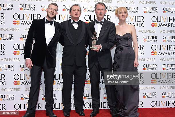 Presenter Russell Tovey David Lan Ivo Van Hove and presenter AnneMarie Duff pose with the award for Best Revival for A View From The Bridge in the...