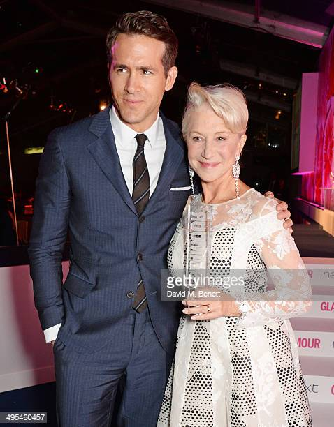 Presenter Ryan Reynolds and Glamour Icon award winner Dame Helen Mirren pose at the Glamour Women of the Year Awards in Berkeley Square Gardens on...