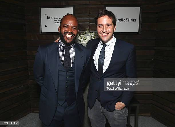 Presenter Sal Masekela and Best Short Form Series award winner AJ Schnack attend the 32nd Annual IDA Documentary Awards at Paramount Studios on...