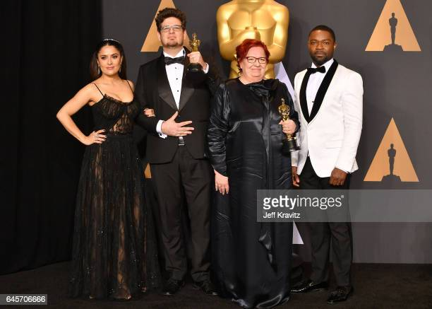 Presenter Salma Hayek, filmmaker Kristof Deak and producer Anna Udvardy, winners of the Best Live Action Short Film 'Sing', and presenter David...