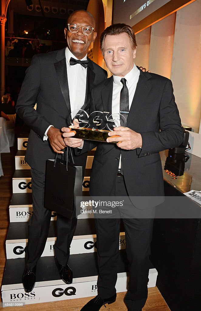 Presenter Samuel L. Jackson (L) and Liam Neeson, winner of the Editor's Special Award, attend the GQ Men Of The Year awards in association with Hugo Boss at The Royal Opera House on September 2, 2014 in London, England.