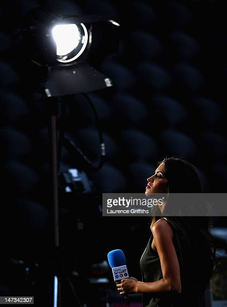 TV presenter Sara Carbonero looks on during during the UEFA EURO 2012 semi final match between Portugal and Spain at Donbass Arena on June 27 2012 in...