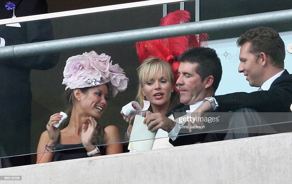 Presenter Simon Cowell , Amanda Holden and unidentified guests enjoy the racing on the first day of Royal Ascot 2009 at Ascot Racecourse on June 16, 2009 in Ascot, England.