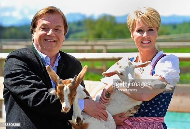 Presenter Sonja Zietlow and Michael Aufhauser pose during a photocall for the TV show 'Sonjas Welt der Tiere' at Gut Aiderbichl on May 15 2013 in...