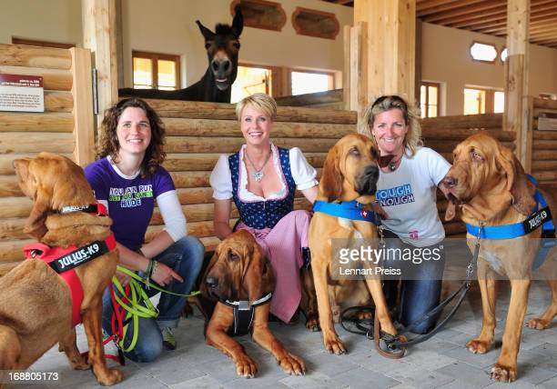 Presenter Sonja Zietlow and the dog trainers Rovenka Langkau and Alexandra Grunow pose during a Photocall for the TV show 'Sonjas Welt der Tiere' at...