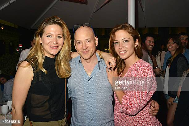 TV presenter Stephanie Loire comedians Evan Handler and Dounia Coesens attend 'La Boumette' Party at L'Opera Restaurant on June 7 2014 in Paris France