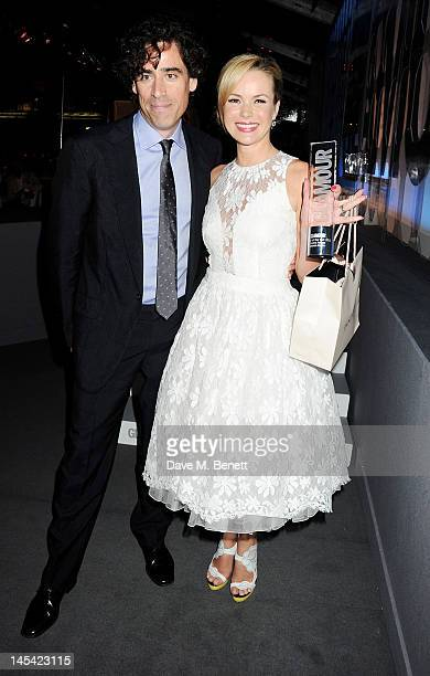 Presenter Stephen Mangan and Theatre Actress of the Year Amanda Holden pose at the Glamour Women of the Year Awards in association with Pandora at...