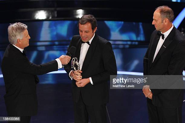TV presenter Steve Ryder speaks with Sandro Rosell Barcelona Chairman on stage after accepting the Laureus World Team of the Year Award on behalf of...