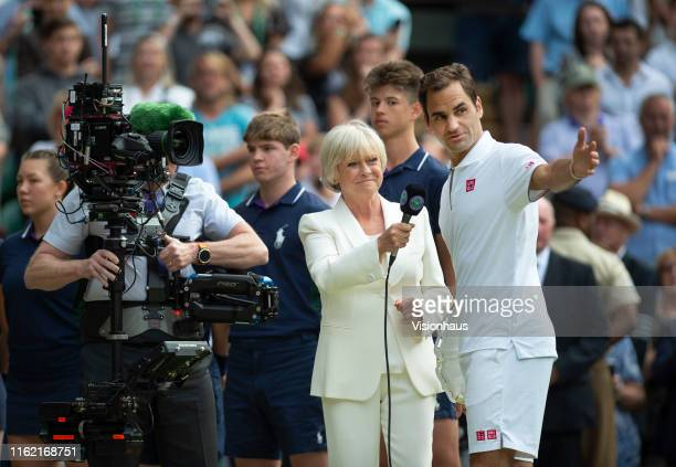 BBC presenter Sue Barker interviews Roger Federer of Switzerland after his defeat to Novak Djokovic of Serbia in the Final of the Gentlemen's Singles...