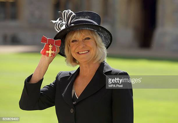 TV presenter Sue Barker poses after receiving her Officer of the Order of the British Empire medal at an Investiture ceremony on April 13 2016 in...