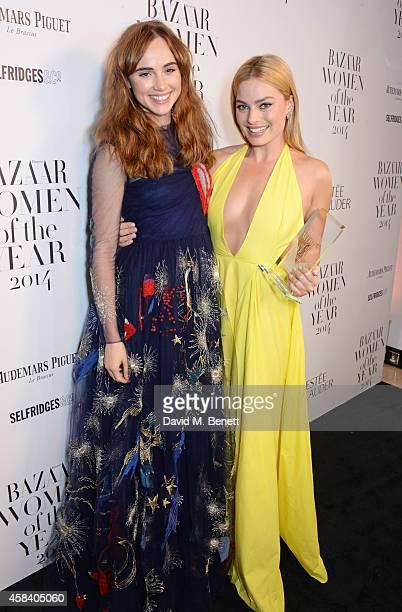 Presenter Suki Waterhouse and Margot Robbie, winner of the Breakthrough award, pose at the Harper's Bazaar Women Of The Year awards 2014 at...