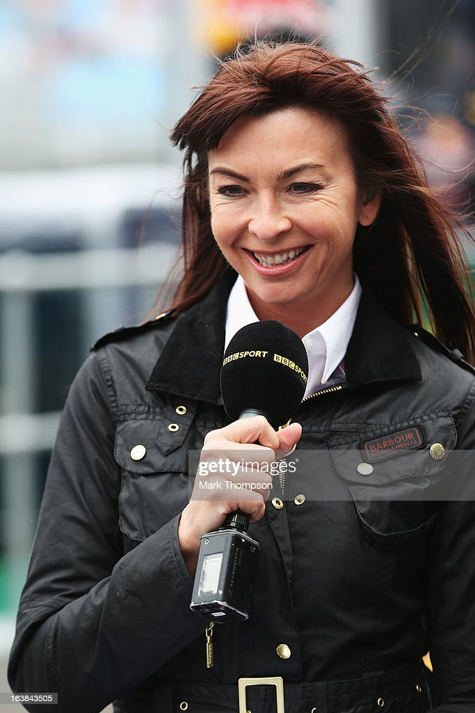 F1 presenter Suzi Perry is seen in the paddock during the weather delayed qualifying session for the Australian Formula One Grand Prix at the Albert Park Circuit on March 17, 2013 in Melbourne, Australia.
