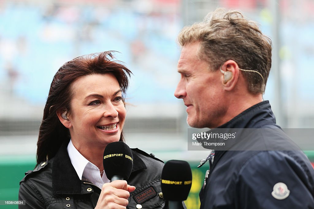 F1 presenter Suzi Perry talks with former F1 driver David Coulthard in the paddock during the weather delayed qualifying session for the Australian Formula One Grand Prix at the Albert Park Circuit on March 17, 2013 in Melbourne, Australia.