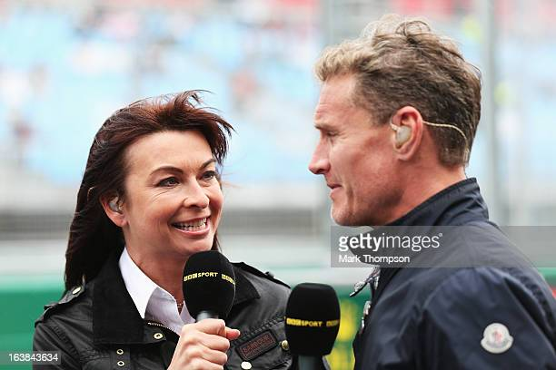 F1 presenter Suzi Perry talks with former F1 driver David Coulthard in the paddock during the weather delayed qualifying session for the Australian...