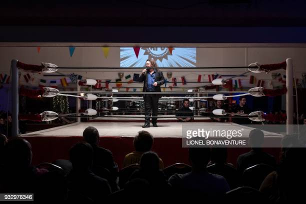 Presenter talks during a wrestling show on March 11 in Nanterre, near Paris. - In Nanterre, the French Association of Professional Wrestling revives...
