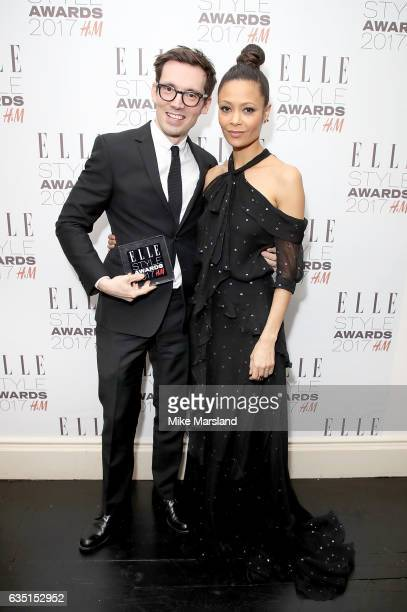Presenter Thandie Newton and winner Erdem Moralioglu pose in the winners room with the British Designer of The Year award at the Elle Style Awards...