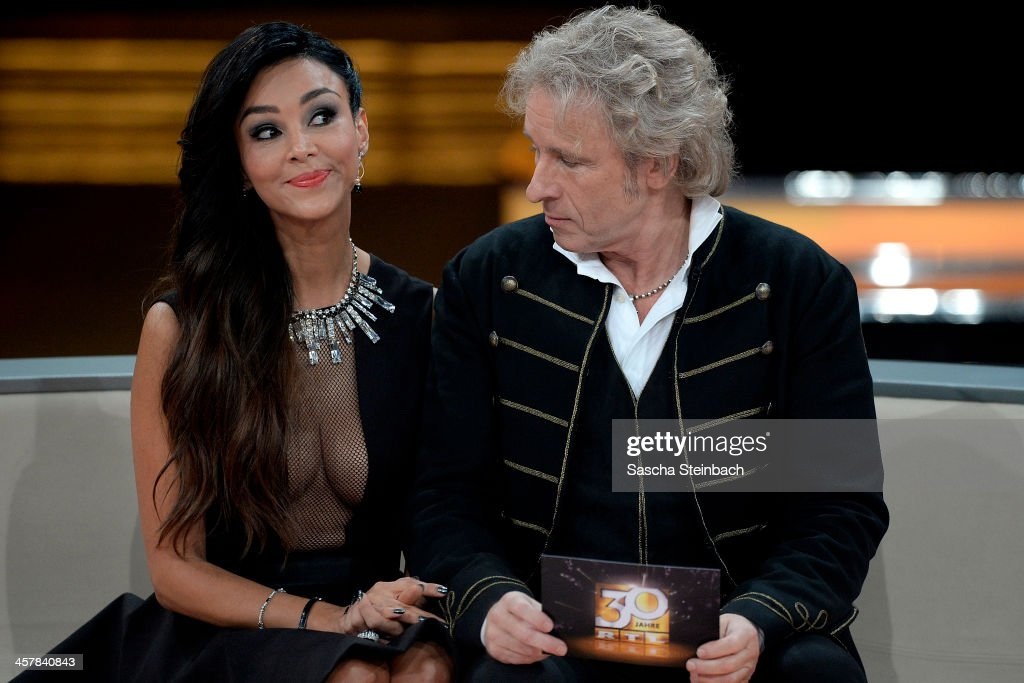 Presenter Thomas Gottschalk (R) looks to Verona Poth's cleavage (L) during the taping of the anniversary show '30 Jahre RTL - Die grosse Jubilaeumsshow mit Thomas Gottschalk' on December 18, 2013 in Huerth, Germany.